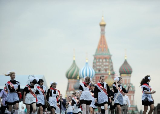 High-school graduates celebrate the last day of their classes on Red Square in Moscow on May 25, 2011. Russian teenagers celebrated the end of their studies across the country. AFP PHOTO / NATALIA KOLESNIKOVA (Photo credit should read NATALIA KOLESNIKOVA/AFP/Getty Images)